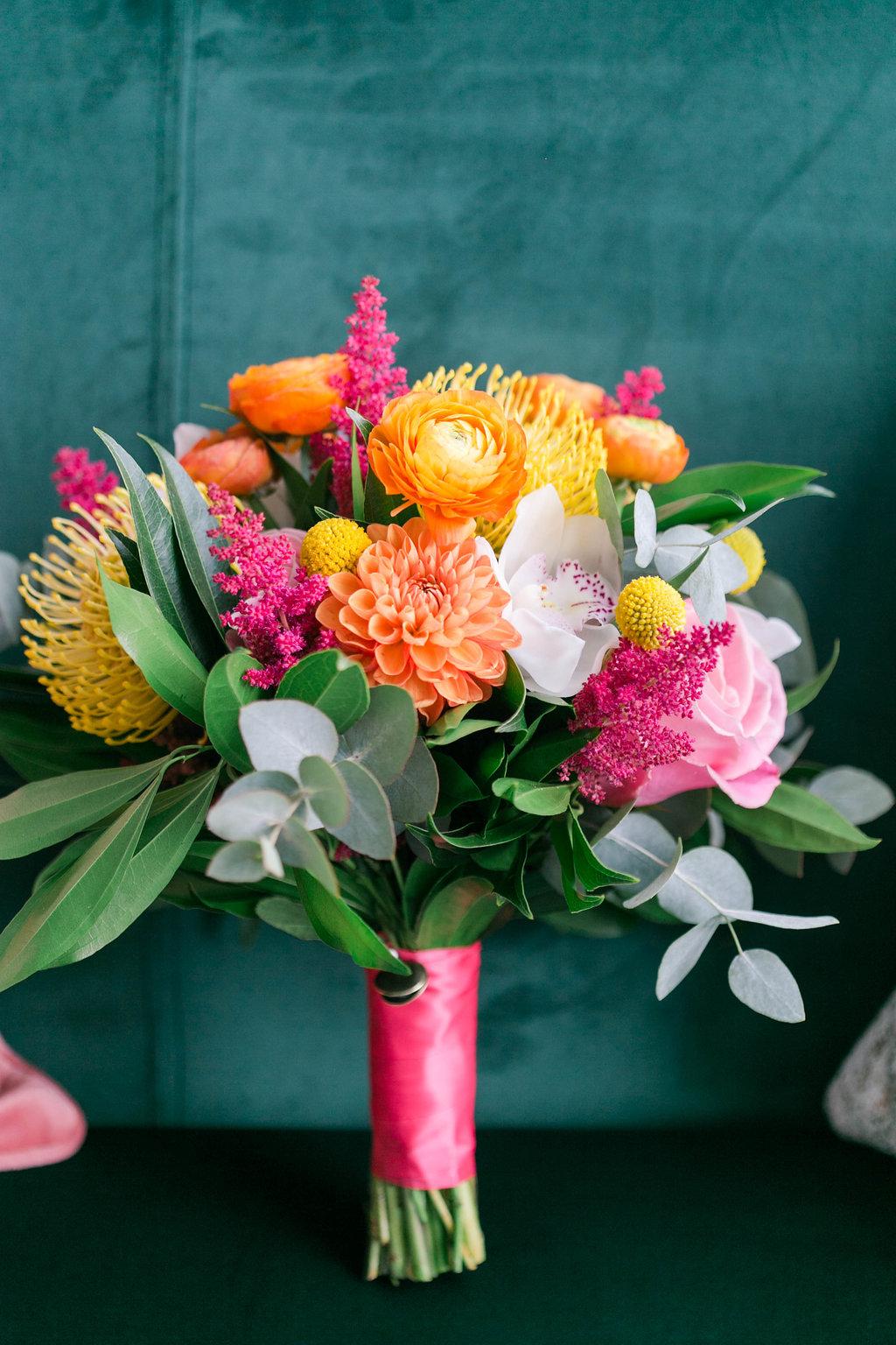 Bright pink orange wedding bouquet