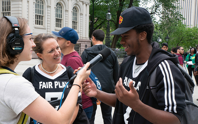 student-speaking-with-WNYC-at-city-hall.jpg