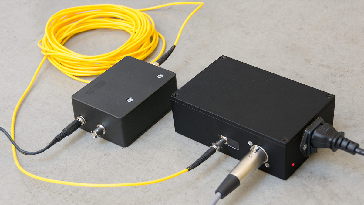 Optical cable transmits the video signal noiselessly out of the scanner room.