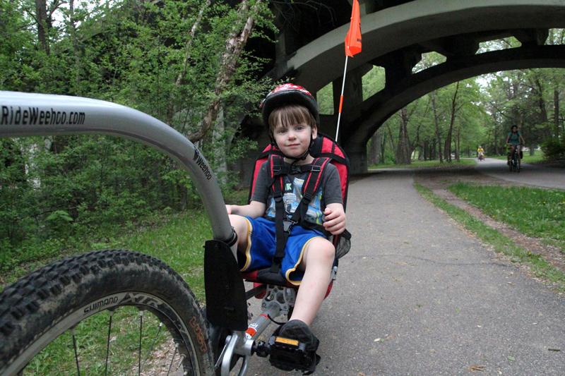 Weehoo® bike trailer on park path.