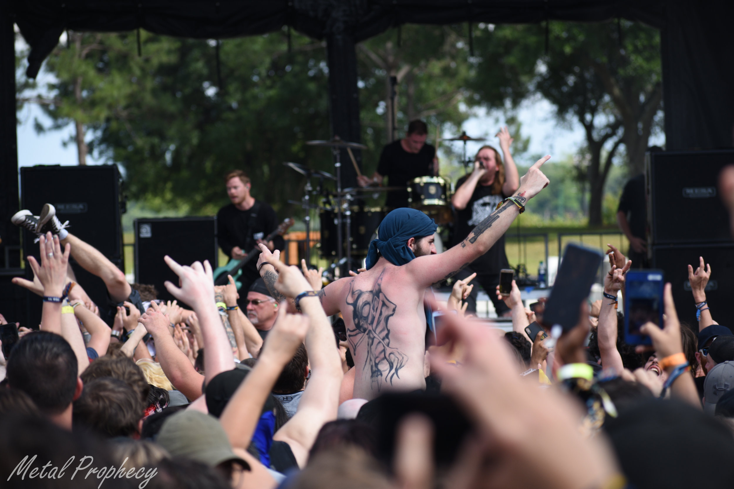A fan crowd surfs to Wage War at Welcome to Rockville 2019