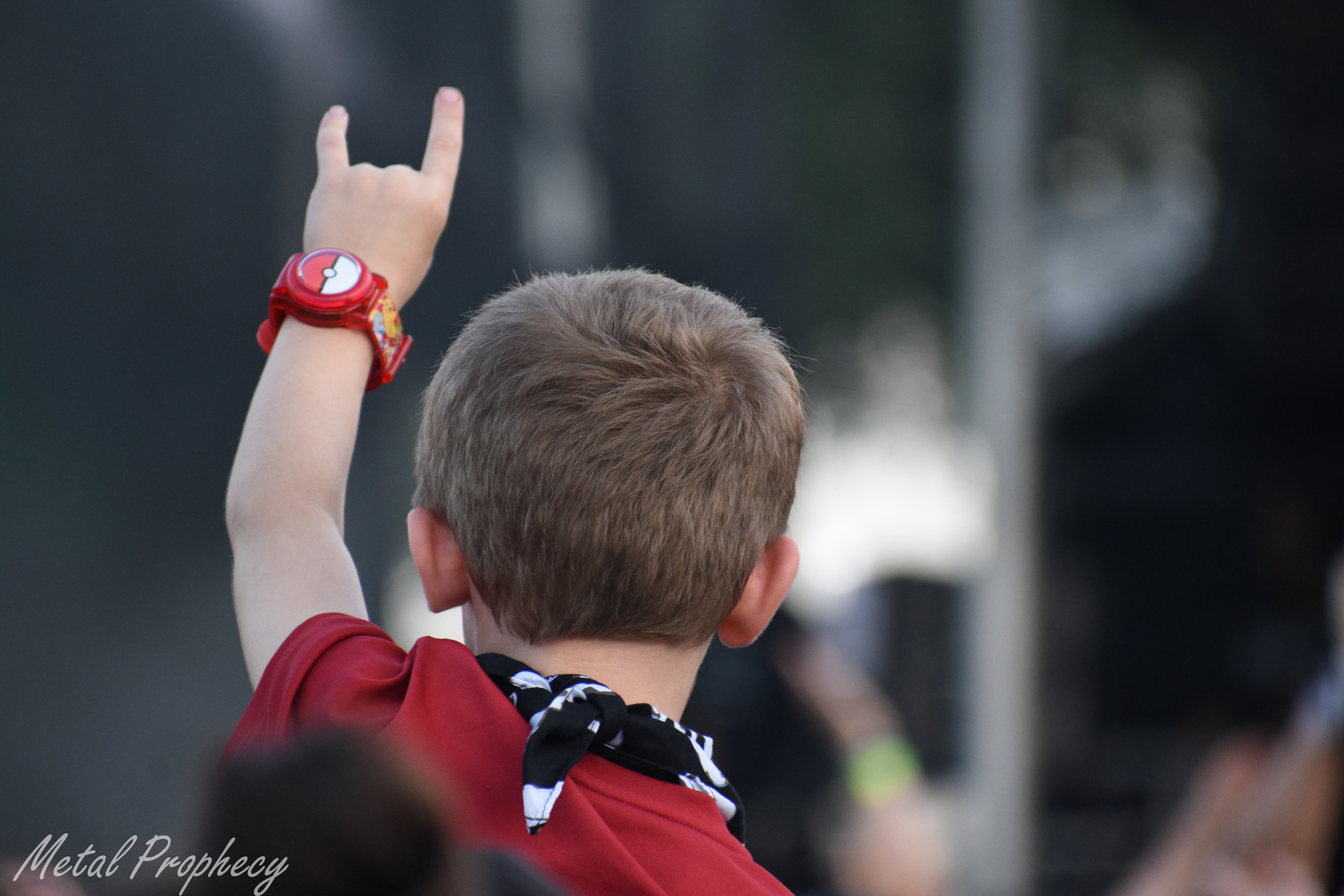 A young fan feels it as Yelawolf performs at Welcome to Rockville 2019