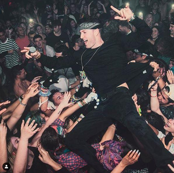 PAZ crowd surfing a Aura Nightclub in California.