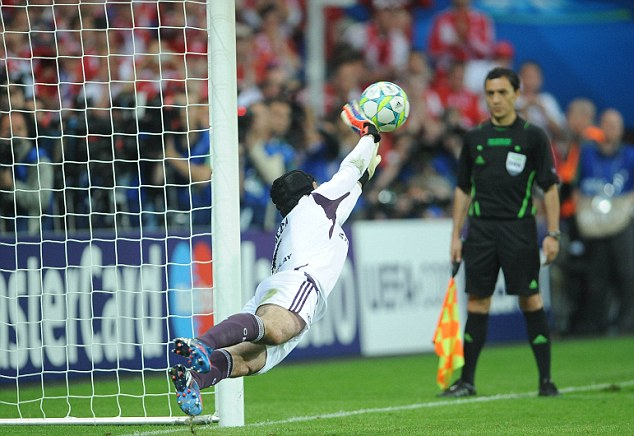 Cech stops Olic in the penalty shootout.