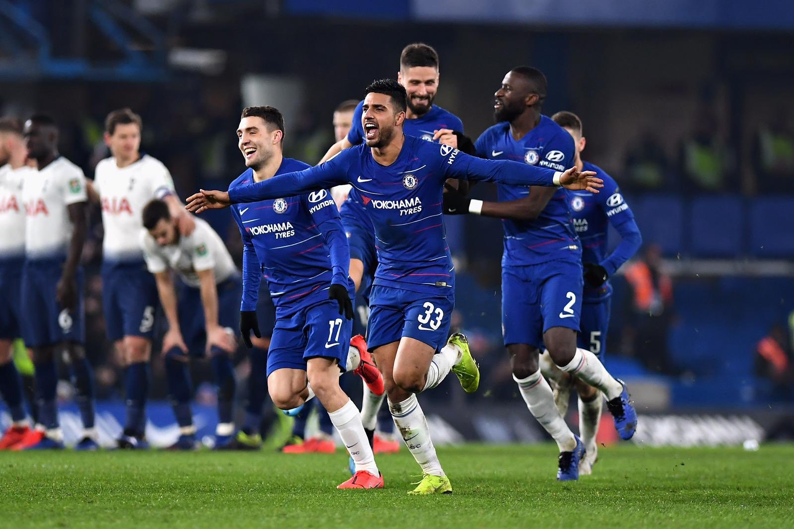 Emerson leads the celebration after Chelsea beat Spurs on penalties.