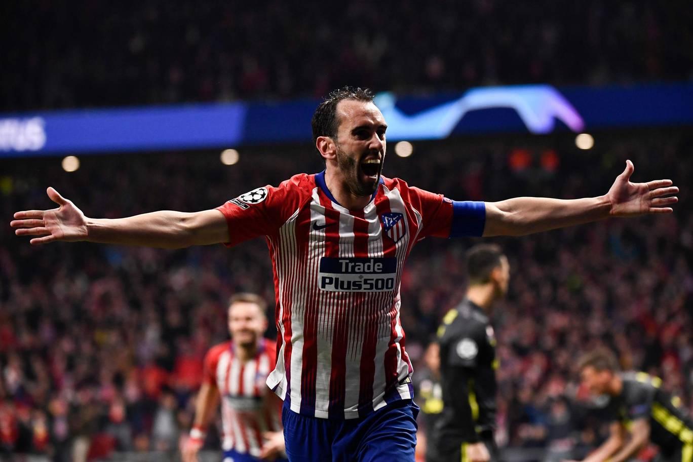 Godin celebrates following his goal - Madrid's second of the match.