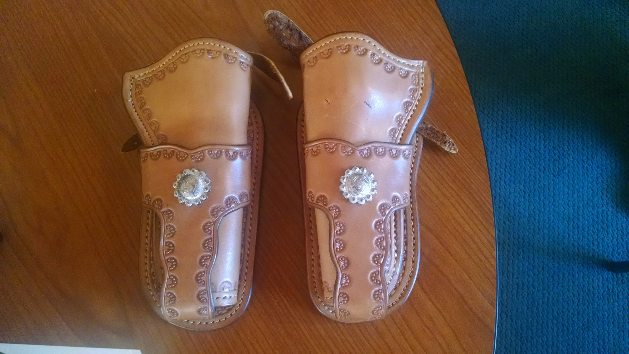 "Matching pair of hand made modified ""Mexican Loop""holsters"