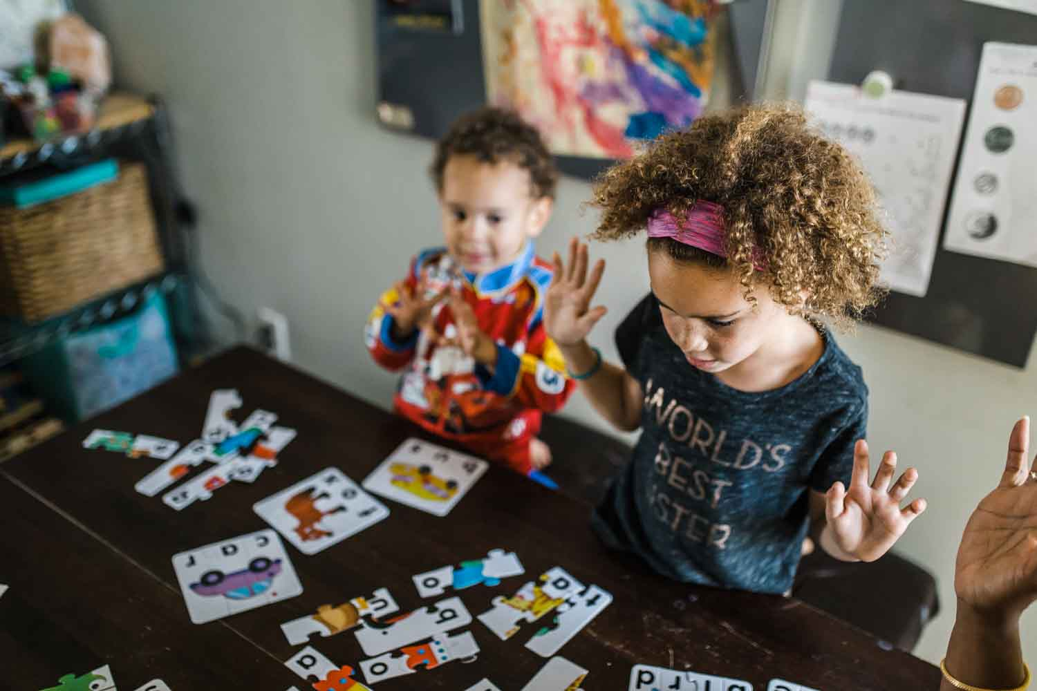 Kids playing with a puzzle at a kitchen table {San Francisco Family Photographer}