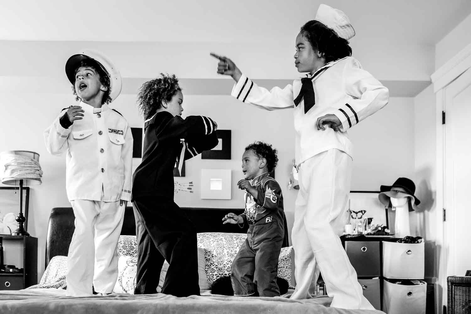 kids dancing on a bed in sailor costumes {San Francisco Family Photographer}