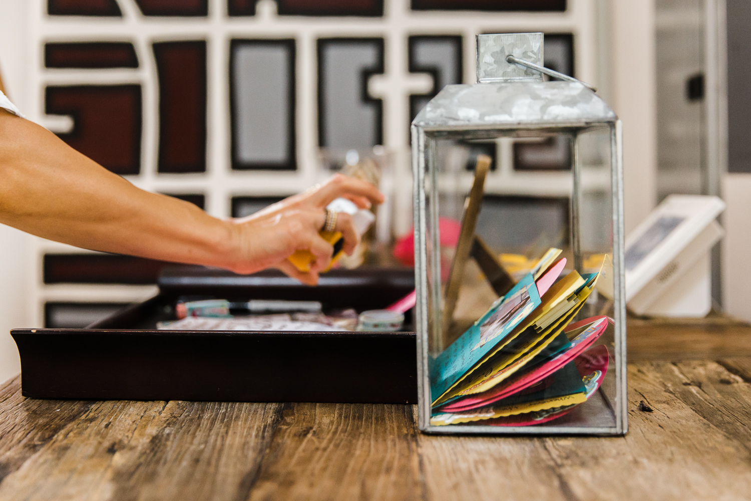 A person's hand as they place a paper into a jar that contains advice for new parents  {San Francisco Newborn Photographer}