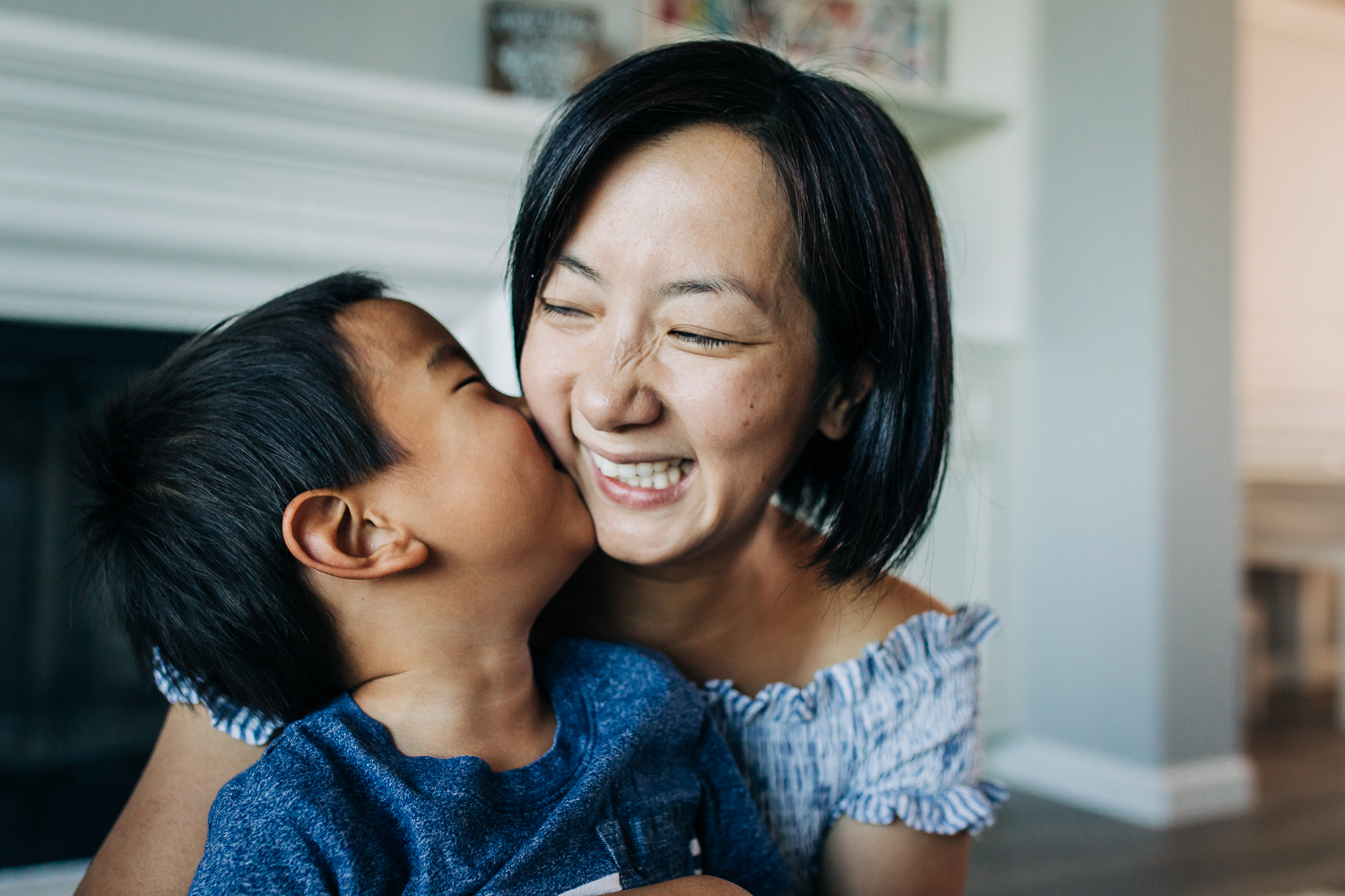 little boy kissing his mom as she smiles | East Bay Lifestyle Family Photographer