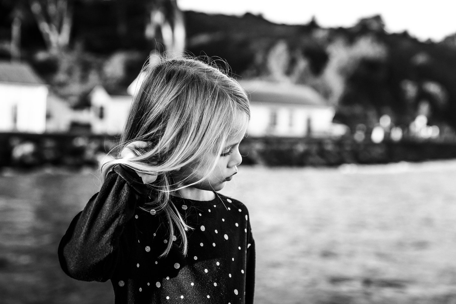 Black and white profile of a 6 year old girl playing with her hair | Bay Area Family Photographer
