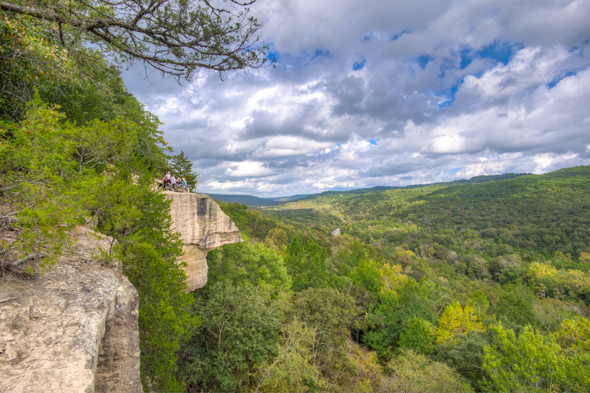 Yellow Rock Overlook, Devils Den State Park in Arkansas. A youth group enjoys fellowship and a view.