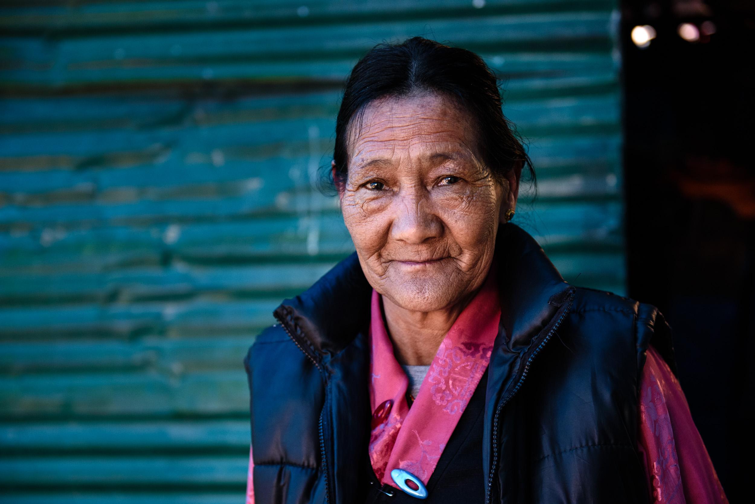 Kusang's wife, Pasan Kipa, outside their home in Ravangla.