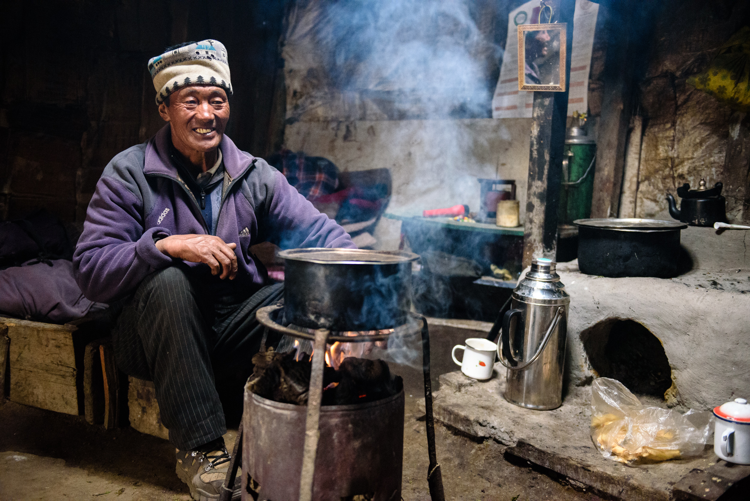 Gya, inside his hut in the Lashar Valley. Three of his six children died from illness. Now, his only son is studying in Gangtok, one daughter serves in the police force in Bangalore, and one daughter has chosen to stay with him and his wife and their yaks. She's the rare individual from her generation who prefers traditional Dokpa life. Gya's wife is a Lachenpa by birth, but she now identifies as a Dokpa; Lachenpa/Dokpa intermarriage is not uncommon.