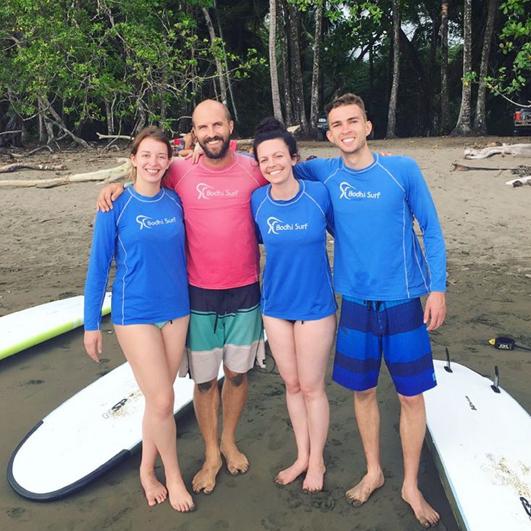 CEO Morgan Berman (left) and Travis Bays owner of Bodhi Surf + Yoga with Chelsey and Weston standing on the beach at Marino Ballena National Park. The MilkCrate team getting the full surf and yoga experience before launching Bodhi's app. Bodhi is our first B Corp and first international client.