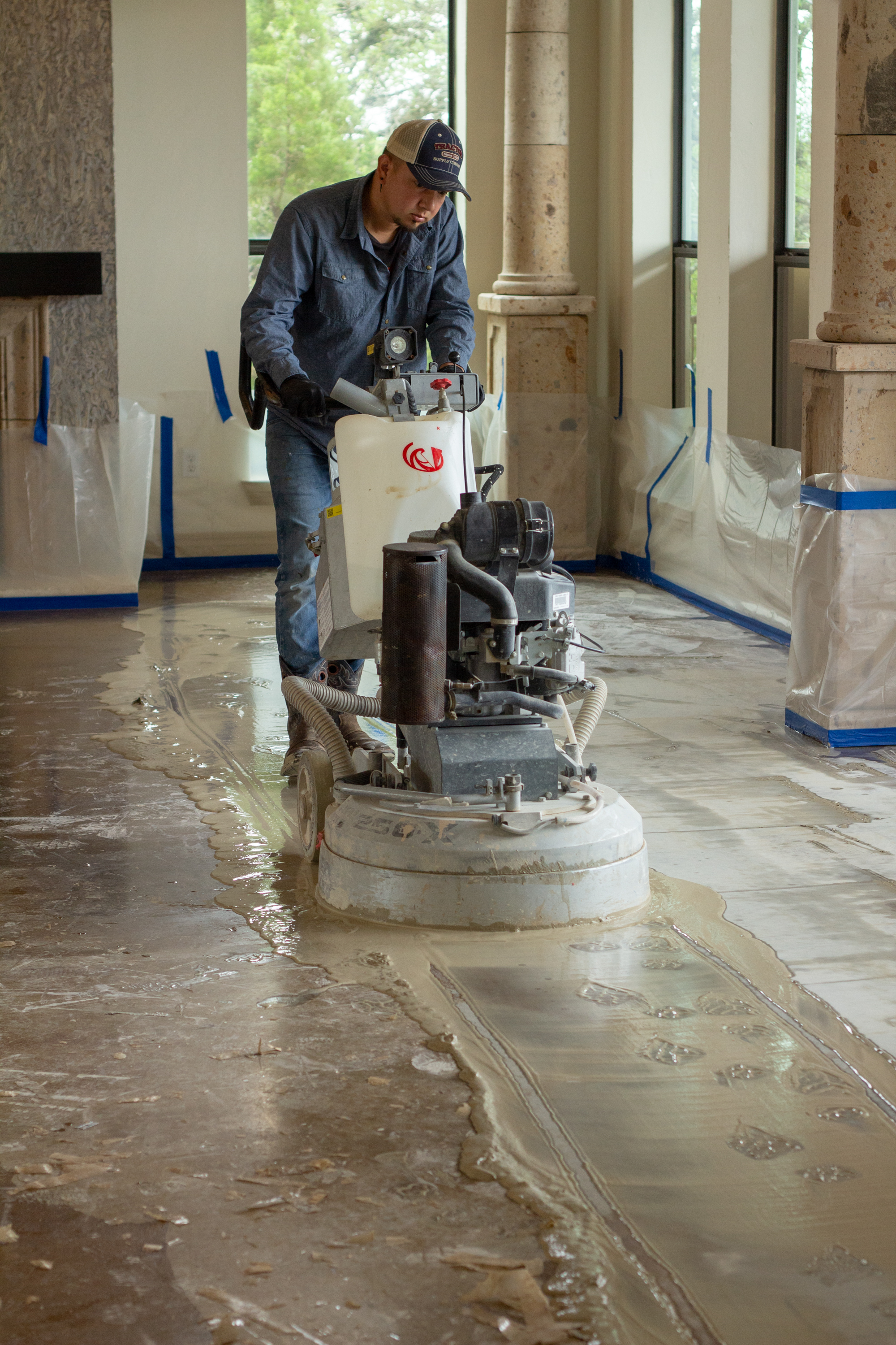 We wet sand the floor to remove the old sealer. - Then we diamond-polish and stain the fresh concrete.