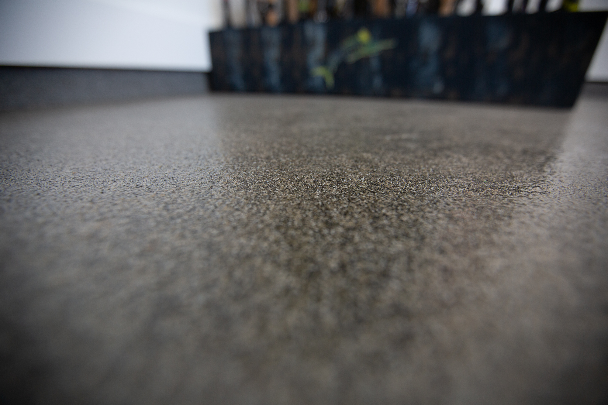 Resin Quartz - This is more impact resistant and skid resistant than any other epoxy flooring with a clean and modern look.