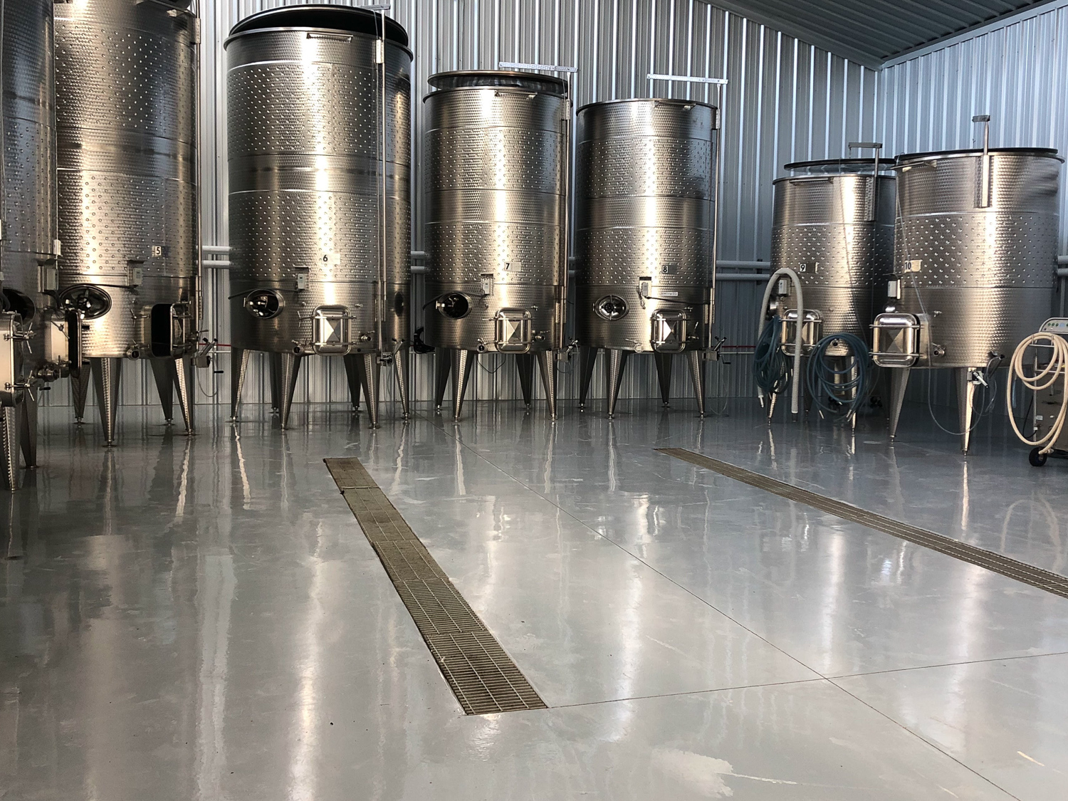 Solid Color Epoxy - Clean modern look - surprisingly hard to do, but we excel at this. This treatment is perfect for airplane hangars or garages where the client wants something visually quiet to find dropped fasteners on.
