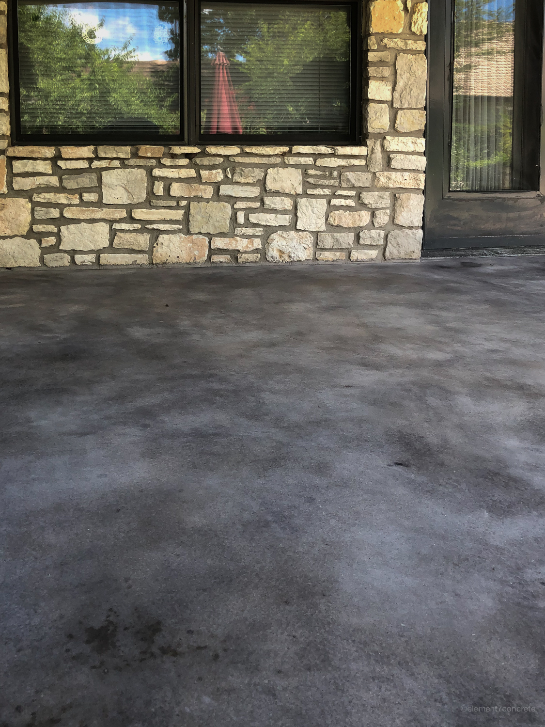 Grey + Grippy - We stained this with a 2-unit loading of grey penetrating stain. We chemically hardened the concrete and left it honed coarsely rather than polishing it. We sealed it with a semi-penetrating sealer.