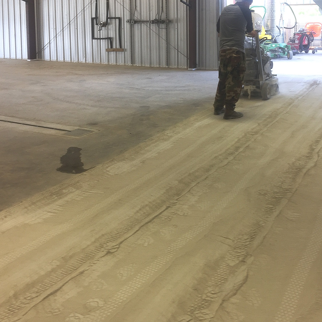 Step 1 - Surface Prep We start by grinding the floor with 14-grit metal bonded diamond abrasives.