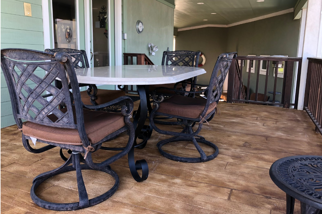 Wood for lakeside living can be a maintenance nightmare! - Instead we install concrete stamped to look like wood.