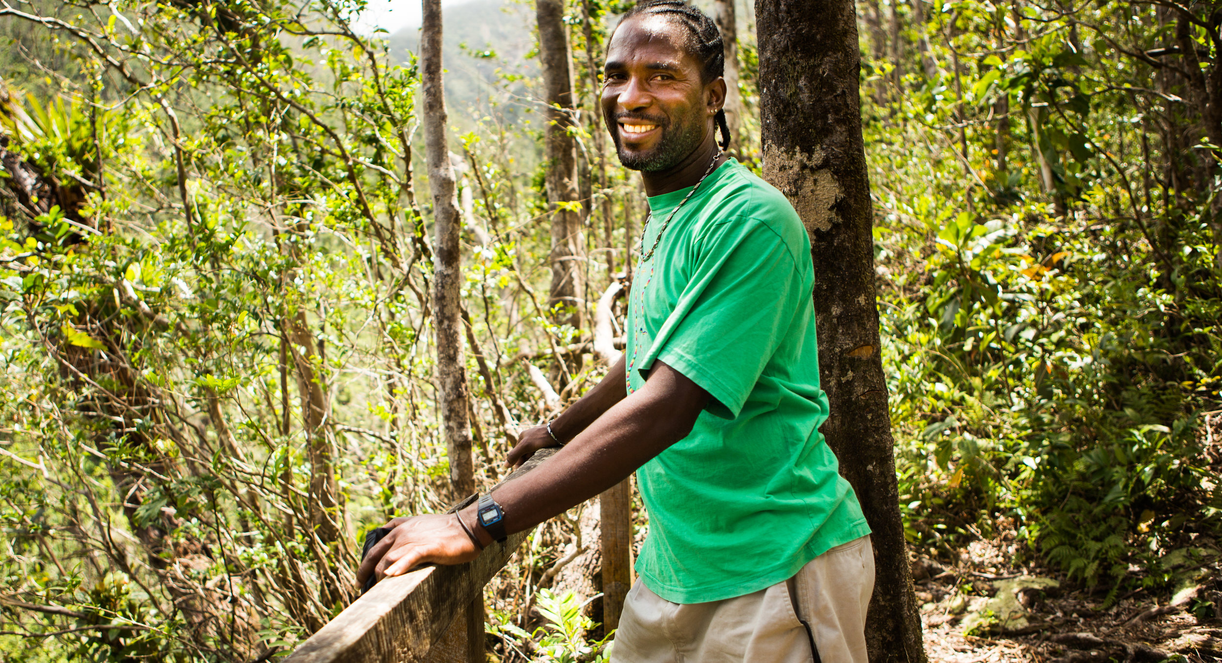 Slim, our awesome tour guide (with the most glorious fingernails in the Caribbean) hiking the Syndicate Trail on Dominica.