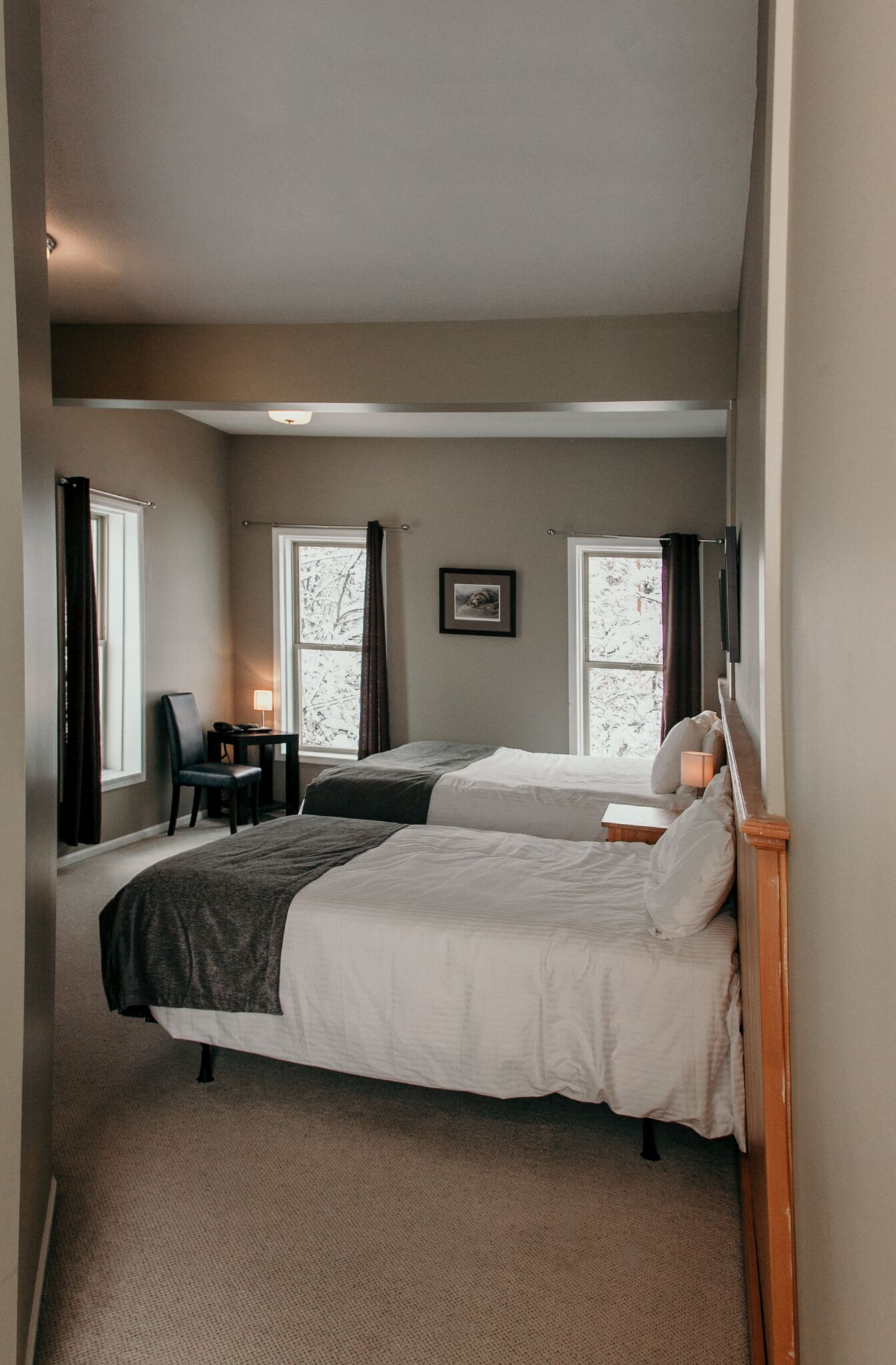 King Suite, featuring a Jacuzzi tub, King and Double beds.