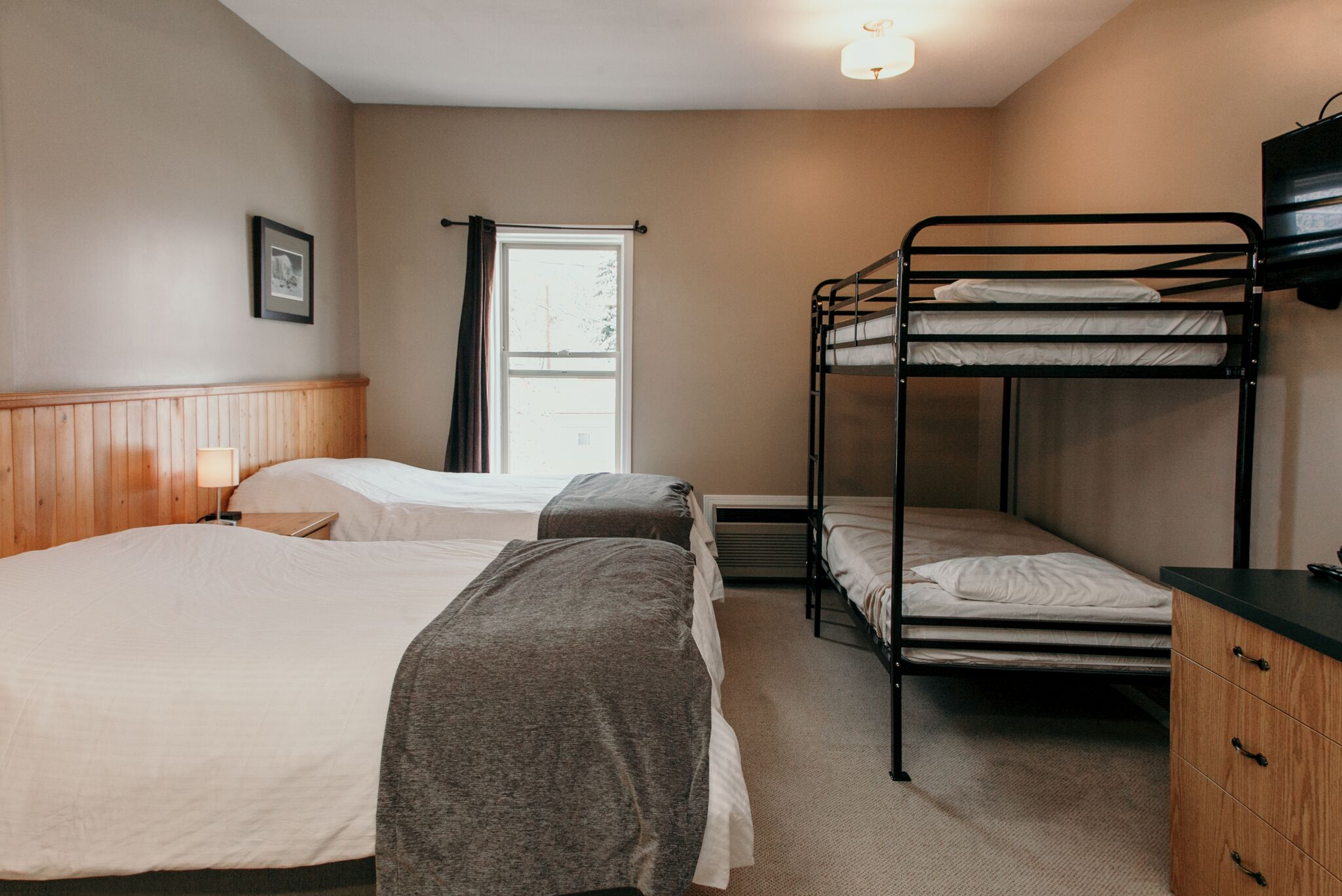 Triple Room, featuring 2 x Double Beds, a bunk bed, bathroom, coffee, and mini fridge.