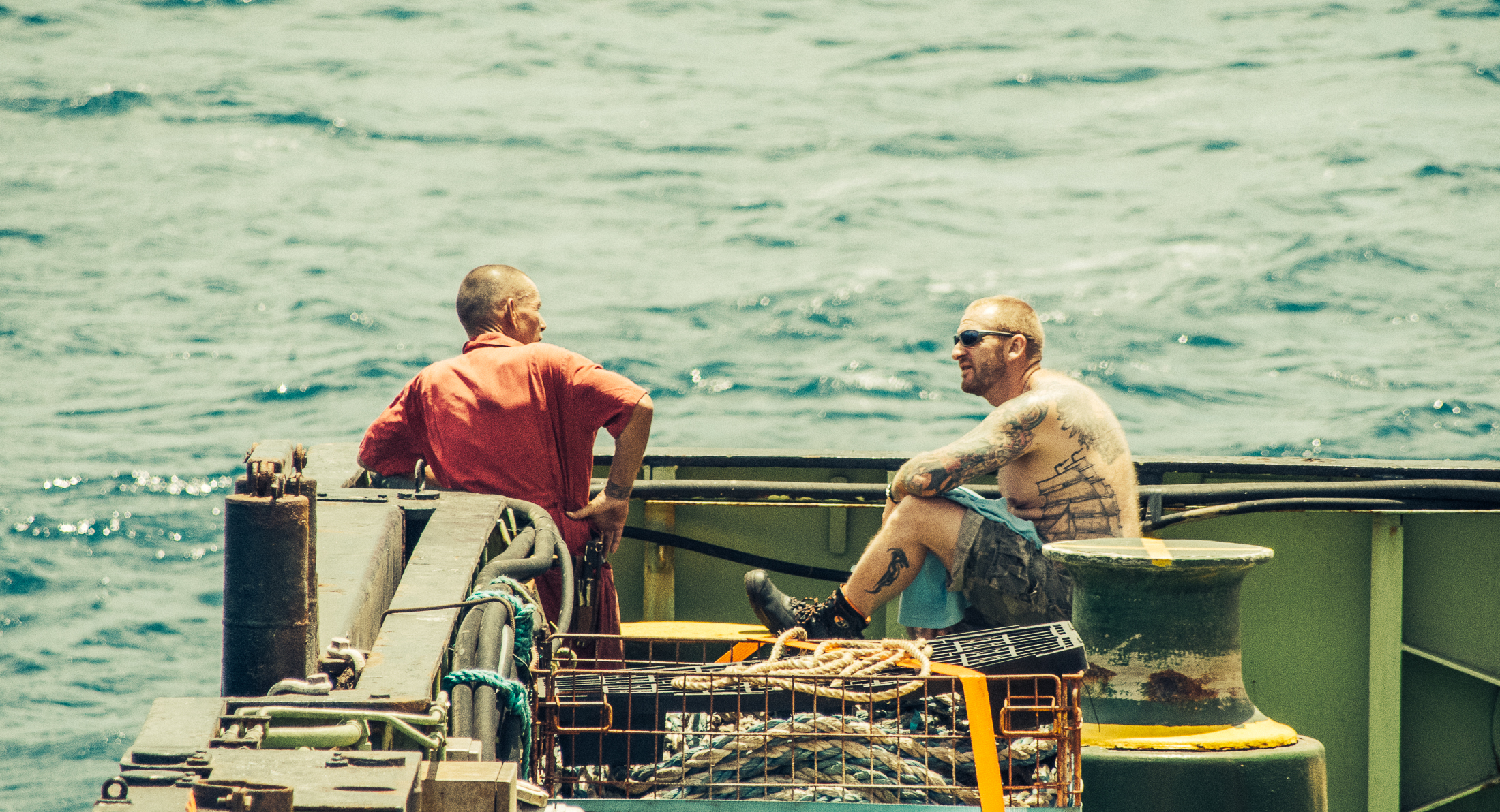Sailors John and Marc resting during one of the few quiet moments at the deck of the ship.