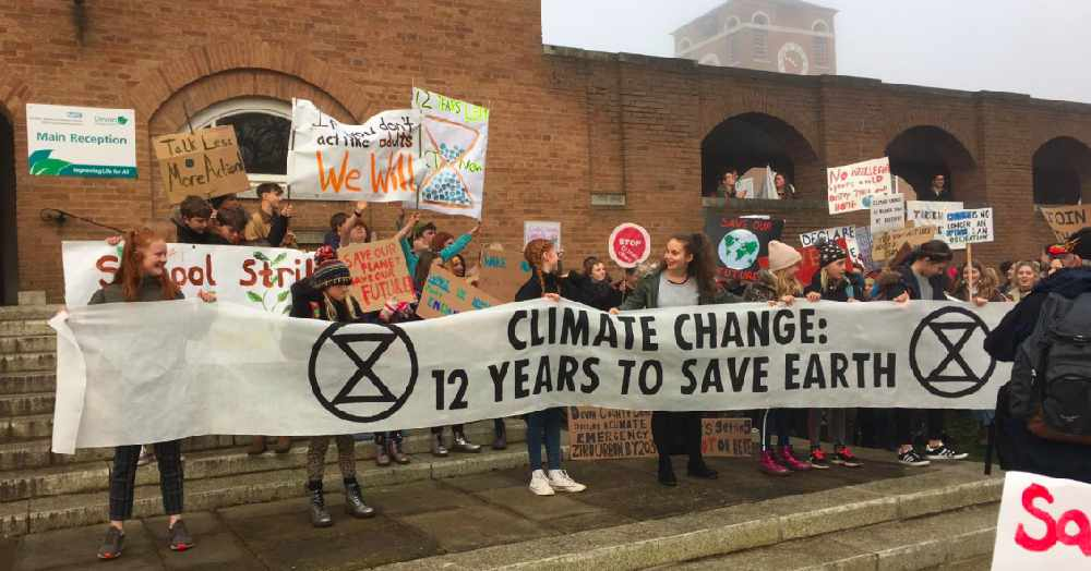 School strikes in Europe protesting lack of action on climate change. Who's holding the banner? Girls. (Photo via Radio exe 107.3 DAB)