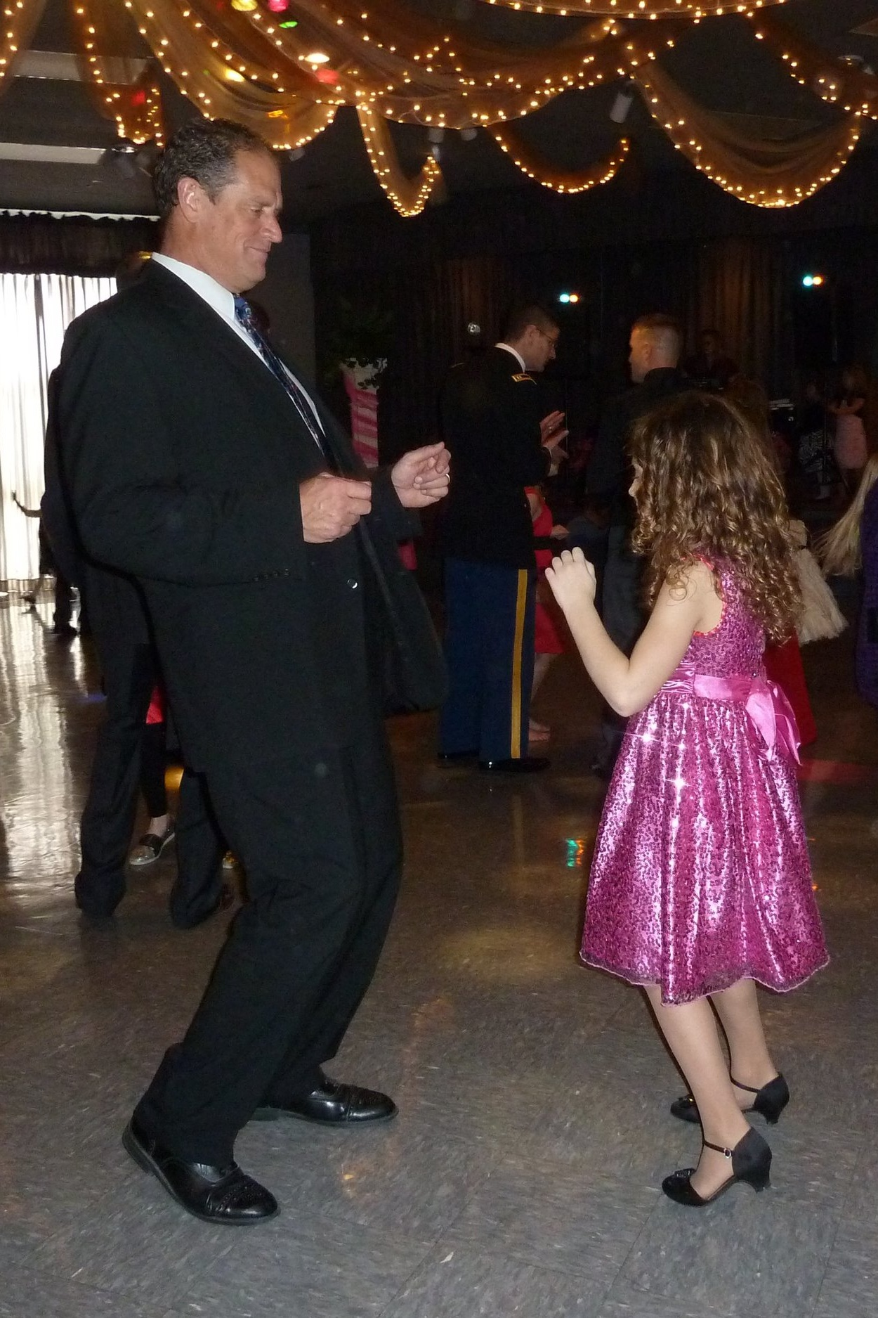 Good ole daddy-daughter dancing (this is not me, nor my father). (Photo via 417Magazine.com)