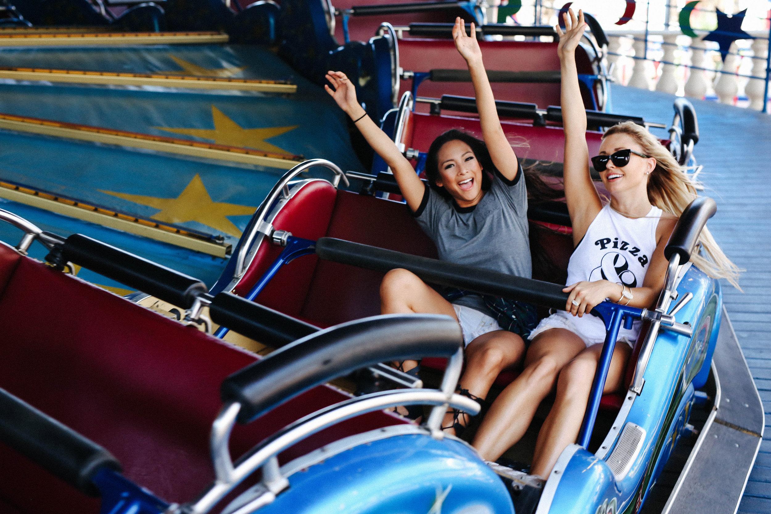 Image of two girls having fun on magic carpet ride.