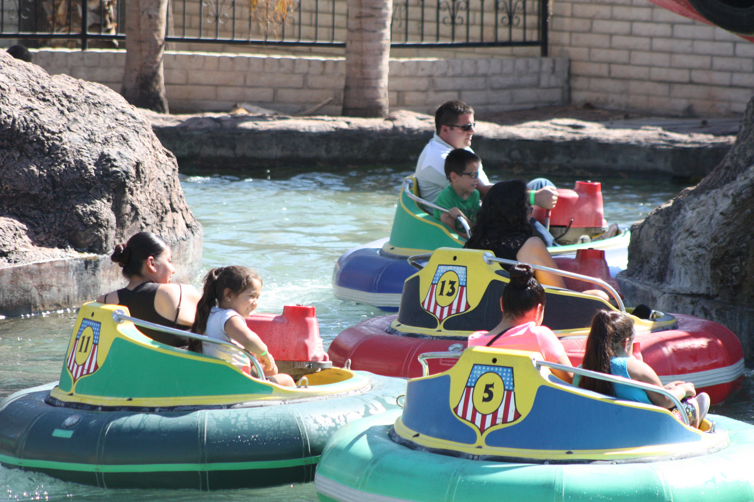 Photo of people having fun on the bumper boats.