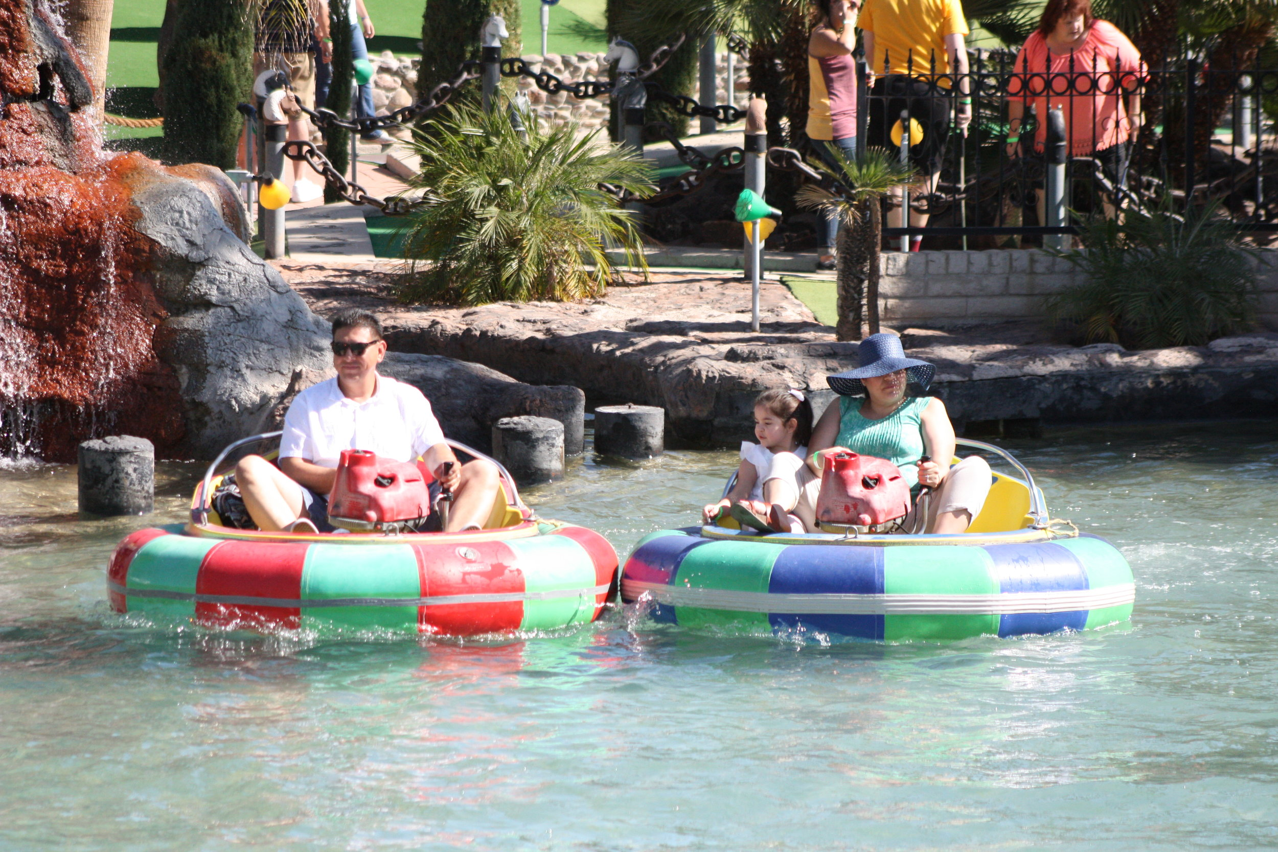 A family having fun on the bumper boats.