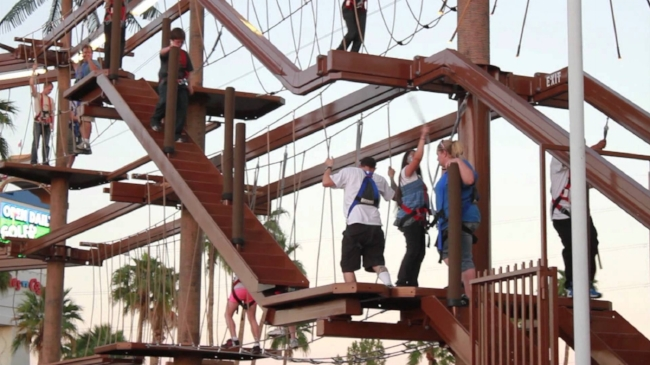Image of brave people taking the on the ropes challenge.