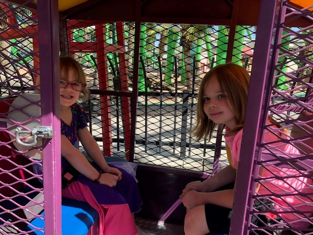 2 girls riding Dixie Junior Wheel