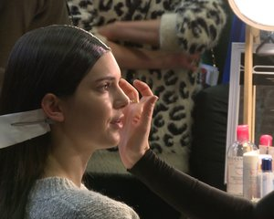 BACKSTAGE BEAUTY  Before every fashion show, the models get the hair and makeup look.  Discover more.