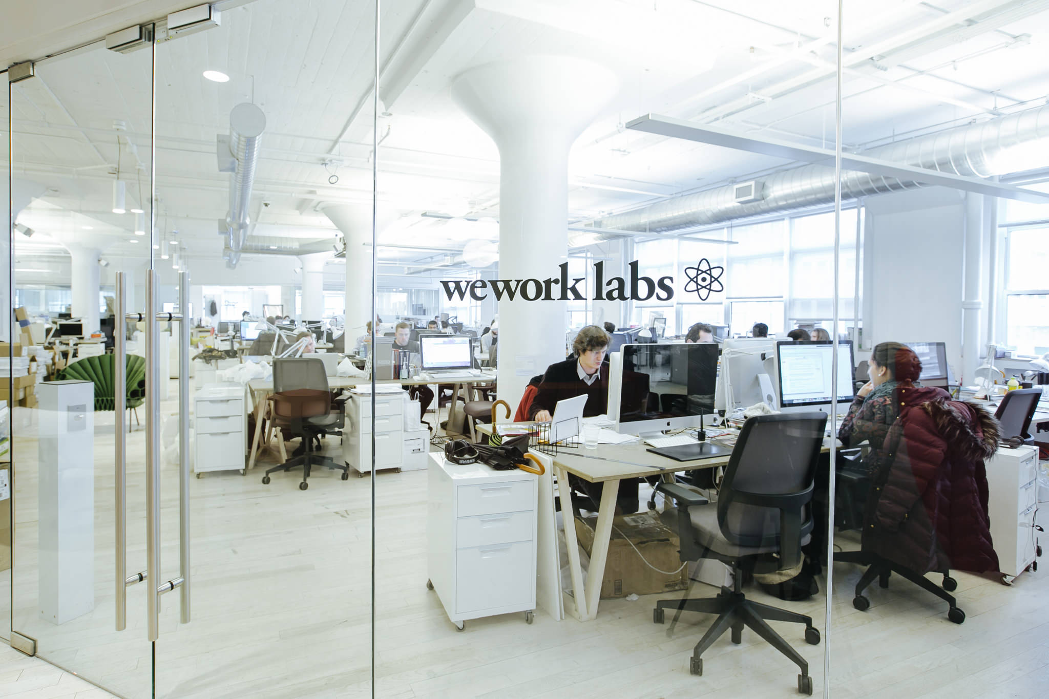 People working in the WeWork Labs at WeWork Varrick Street, New York. MEP designed by 2L Engineering.