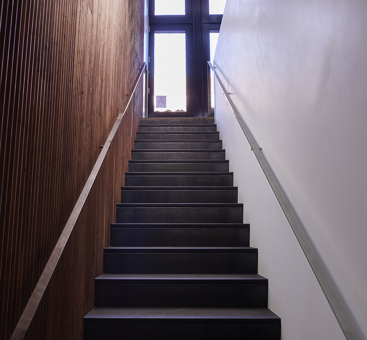 Stairs leading to the bakery, Baked, located in Tribeca. MEP provided by 2L Engineering, a New York based firm.