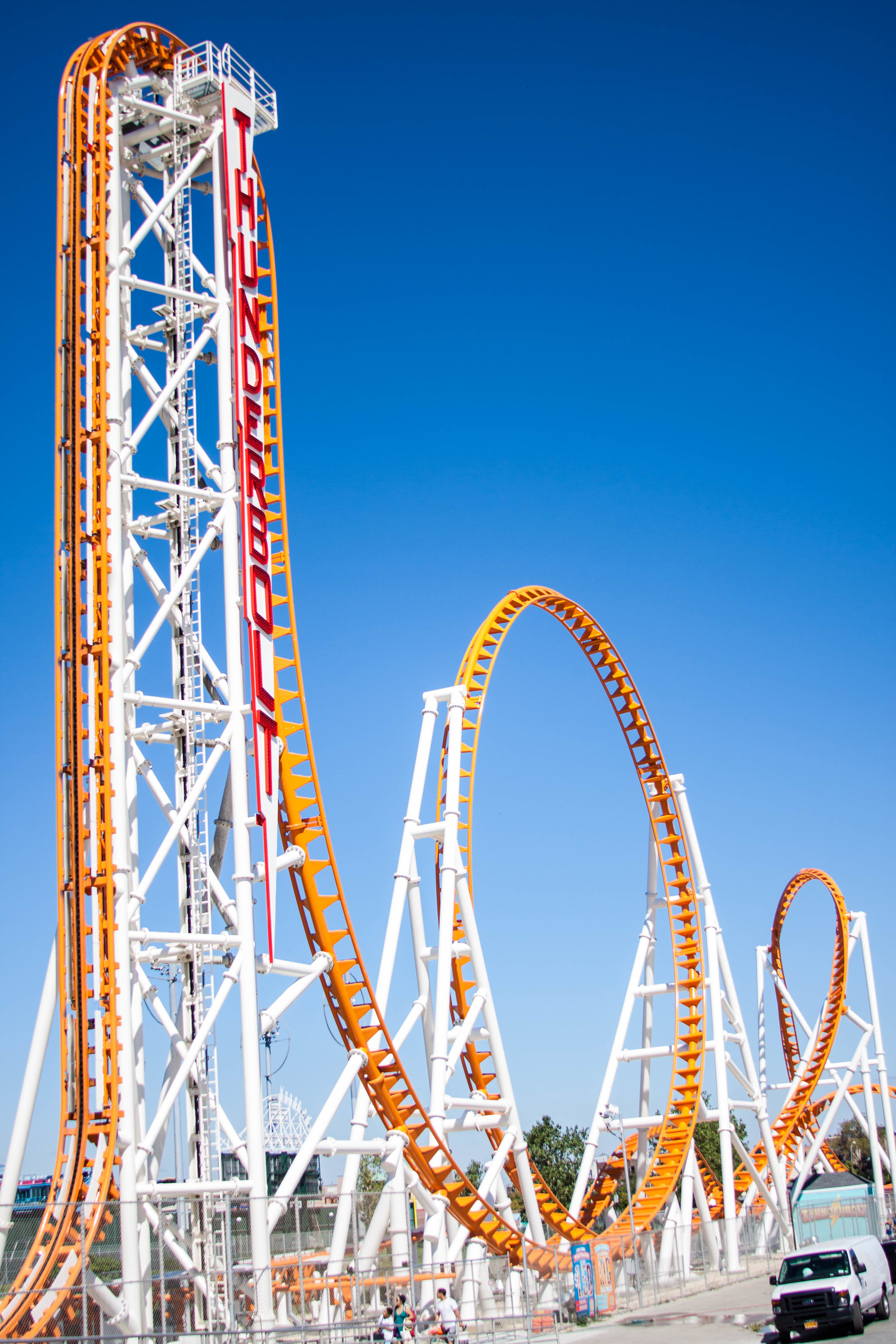 Wideshot of the Thunderbolt Roller Coaster, a steel roller coaster manufactured by Zamperla on Coney Island's Luna Park. MEP by 2L Engineering.