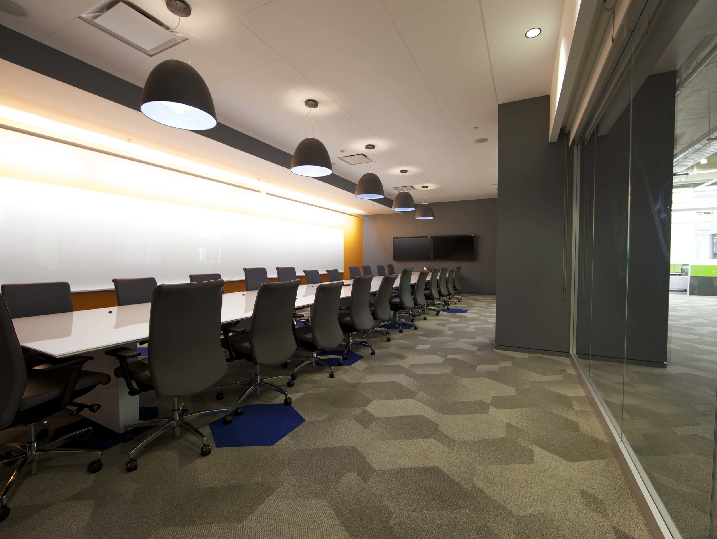 Conference room with hexagon carpet tiles in the Rocketfuel headquarters. MEP by 2L Engineering.