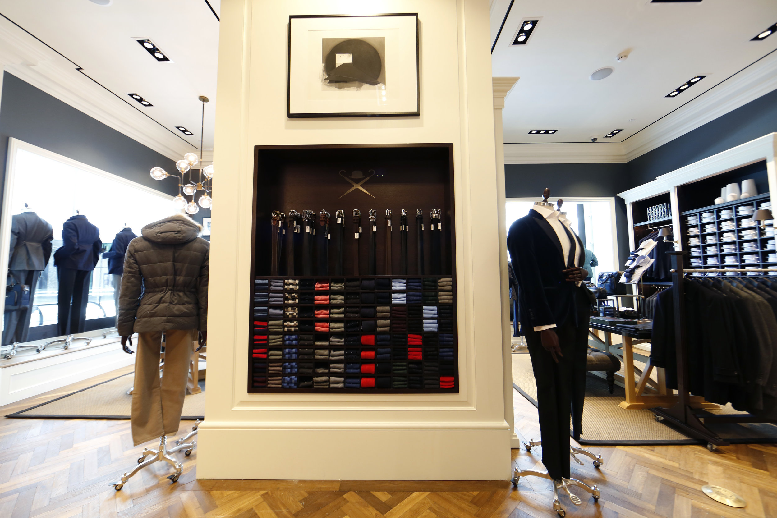 Belt and necktie display in the middle of Hackett London's retail store in Woodbury Common Premium outlet. MEP designed by 2L Engineering.
