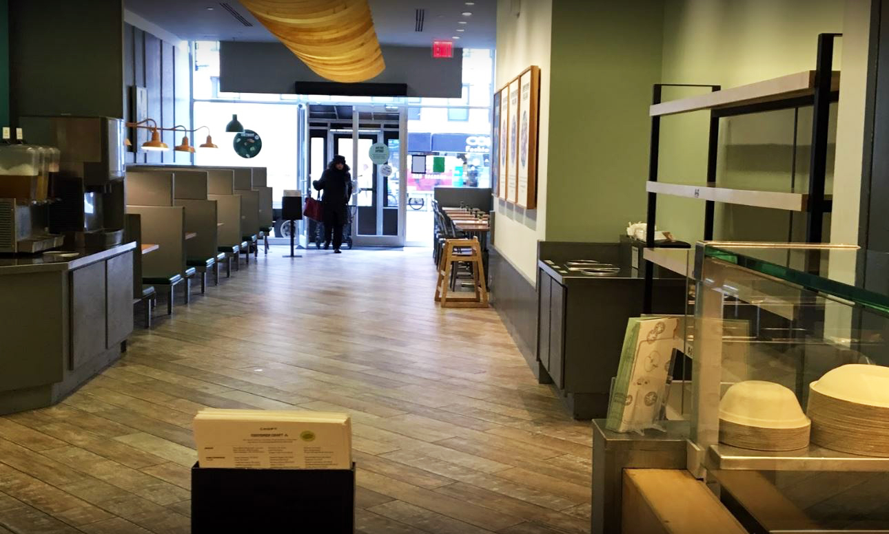 View of the entrance and seating area from the serving area of Chop't Salad's Upper East Side location. MEP provided by 2L Engineering, a New York based firm.