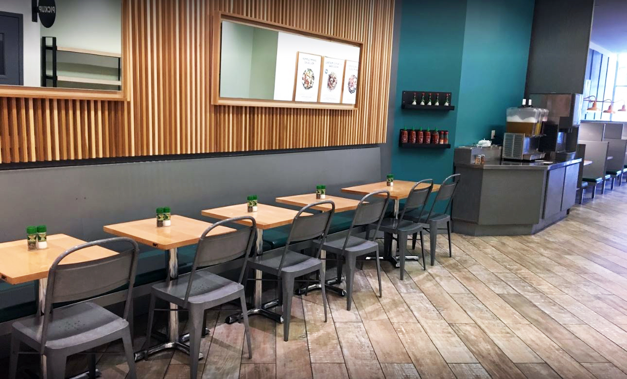 Seating area with wood paneled walls and wood floors in the Upper East Side location of Chop't Salad, a creative salad company. MEP provided by 2L Engineering.