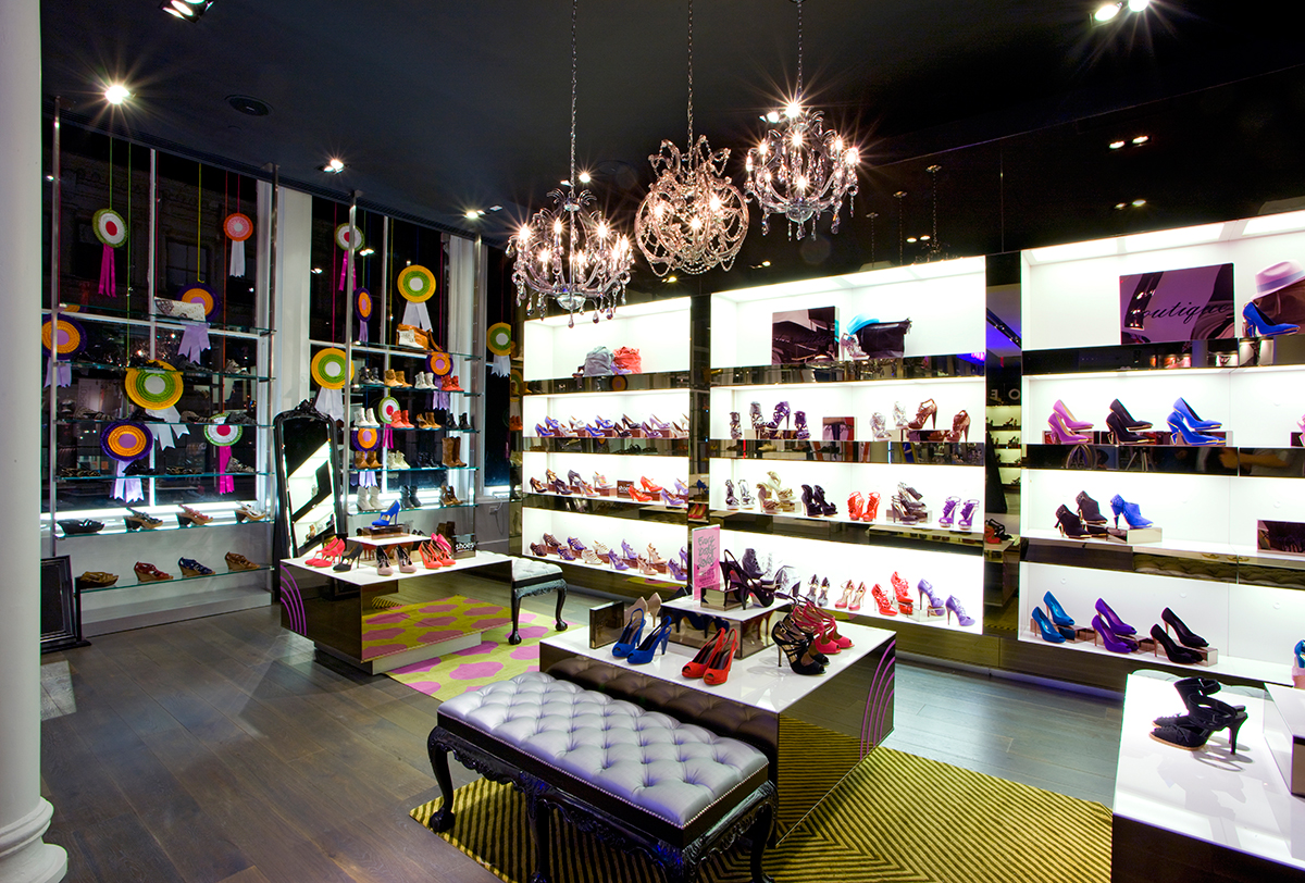 Colorful womens shoes on brightly lit shelving and benches for customers to try on. MEP designed by 2L Engineering.