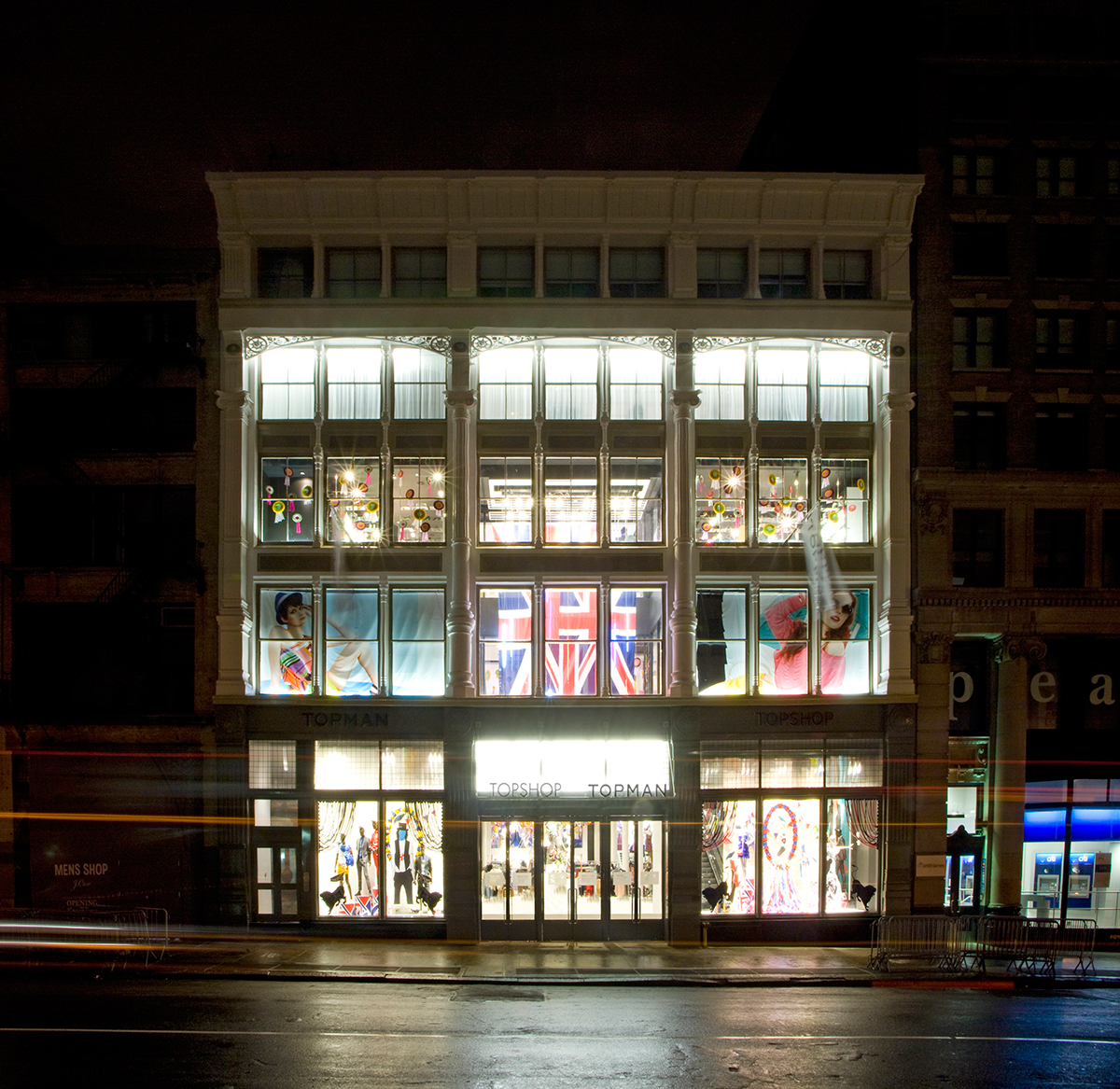 Brightly lit exterior with a prominently displayed Union Jack at the Topshop Topman store in New York. MEP designed by 2L Engineering.