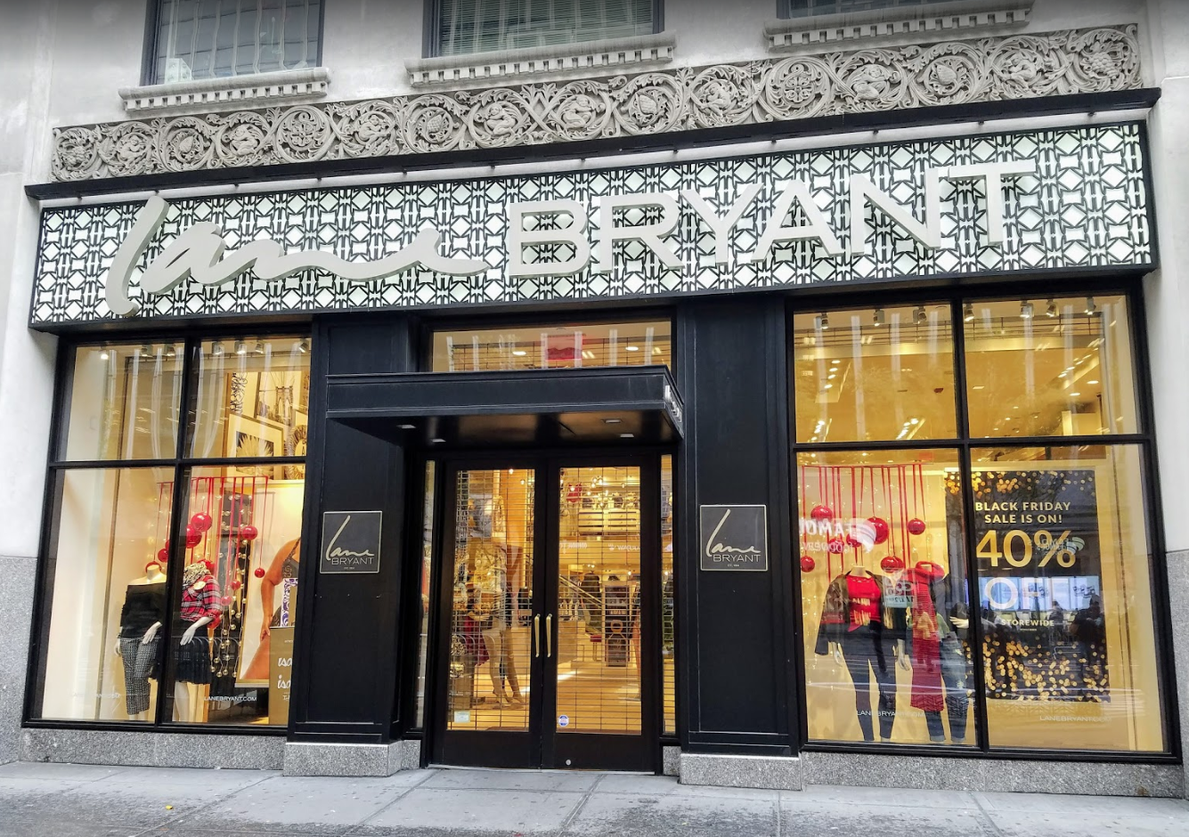 Exterior view of the Lane Bryant flagship retail store at Herald Square in Midtown Manhattan, with a tiled background behind the logo. MEP designed by 2L Engineering.