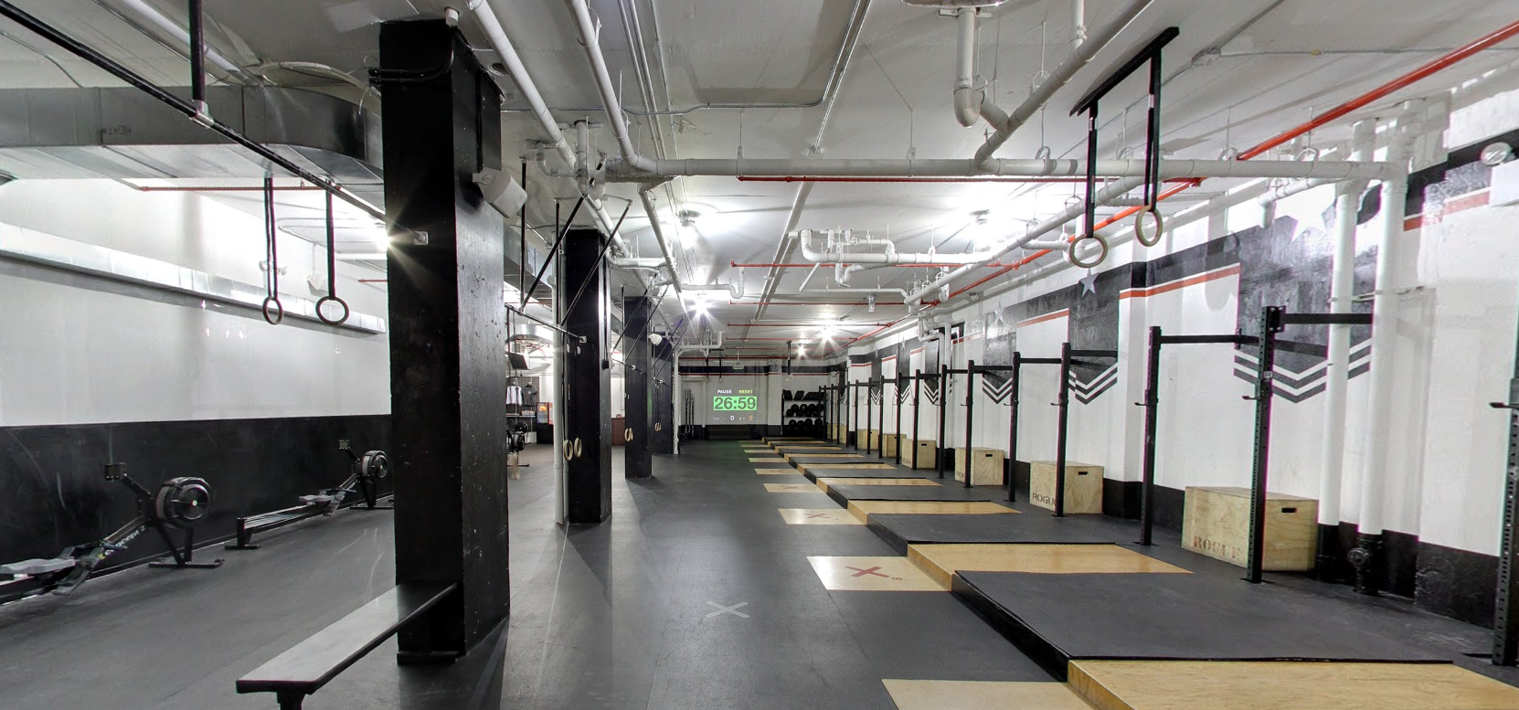 Different fitness equipment laid out across the studio of Crossfit's Tribeca location in New York. MEP for the space was designed by 2L Engineering.