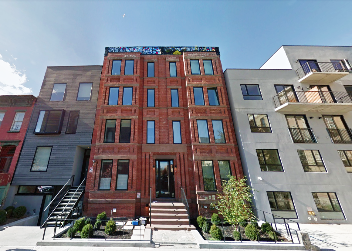 Exterior view from the sidewalk looking up at a luxury brownstone in Brooklyn. MEP provided by 2L Engineering.